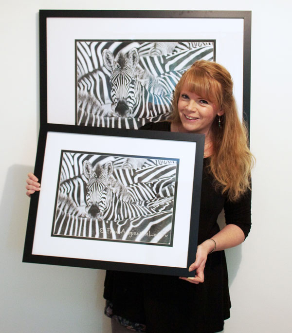 Wildlife artist Angie with Lost in a Crowd Zebra portrait
